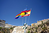 Spanish and EU flags flying on the beach at Torremolinos, Costa del Sol, Spain