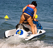 Woman rides on back of Jetski in the Mediterranean Sea