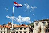 Croatia Flag flying in front of the Sponza Palace, Dubrovnik