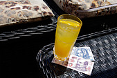 Kuna (HRK) (Croatian currency) and glass of orange juice